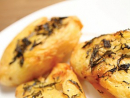 Roast potatoes: Peel some local potatoes and parboil. Bash them a bit so they're flat, drizzle with olive oil, season with salt and pepper then roast in a hot oven until brown and crispy. Make pretty with herbs or leaves.