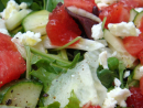 Nav's watermelon and feta salad: Layer chopped red onion, seedless watermelon and feta in a bowl. Top with sprigs of mint. Yummy and refreshing.