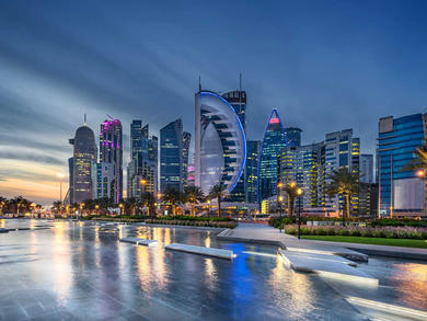 What are the four phases of reopening after lockdown in Qatar?