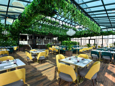 Greenery-filled restaurant Glass House opens at Al Aziziyah Boutique Hotel